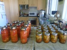 Canned crushed tomatoes in Fowlers vacola Jars and canned turkey and vegetable soup.