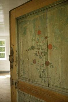 welcoming wood stenciled door of summer home in Sweden