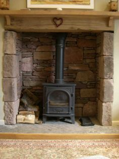 wood burning stove fireplace design ideas small of captivating stone stacked black iron prefabricated wood burning stove fireplace design unfurnished untouched wood home interior decorations ideas Fireplace Hearth Stone, Wood Stove Hearth, Log Burner Fireplace, Stone Fireplace Designs, Inglenook Fireplace, Fireplace Ideas, Fireplace Pictures, Fireplace Mantel, Sandstone Fireplace