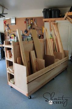 Build 4 shelves with open ends to store loose lumber; install pegboard on outside with hinges