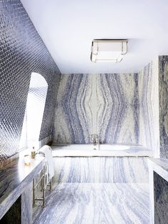 White and blue marble and tile bathroom