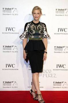 e226f79a0b Cate Blanchett posed on the red carpet in a black peplum skirt at the IWC  watches gala dinner during the Dubai International Film Festival at  Royal  Mirage  ...