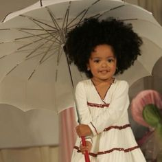 What a cutie! And her dress looks Ethiopian...so sweet!