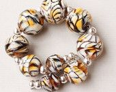 Our yummy 'Tiger' beads have been featured in a new Etsy Treasury!! :-)