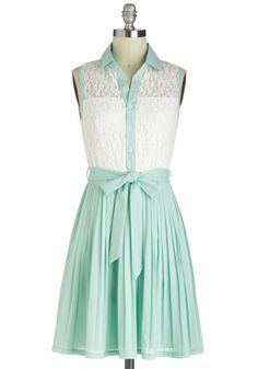 Mint skirt with a white shoulder length lace white shirt