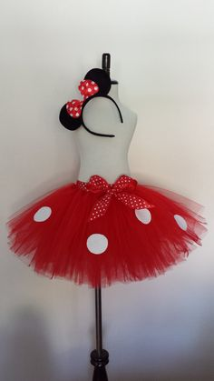 Minnie Mouse Inspired Tutu Skirt with Ears This Minnie Mouse Inspired Tutu is made with red tulle for the bottom and a matching polka dot bow. Simply elegant for your sweet little one. Great Halloween