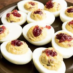 Thanksgiving Cranberry Deviled Eggs Recipe - Our deviled eggs recipe topped with tasty cranberry sauce makes for the perfect appetizer. Add thes - Vegetarian Thanksgiving, Thanksgiving Side Dishes, Thanksgiving Recipes, Holiday Recipes, Fall Recipes, Thanksgiving Appetizers, Thanksgiving Holiday, Holiday Ideas, Bacon Deviled Eggs