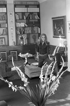 Dalida posing in her house