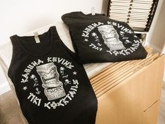 @ KahunaKevin.com - I've got a couple Kahuna Kevin's Tiki Cocktails logo women's ribbed tanktops (Small) and t-shirts (XS, S, M) floating around the office. Custom inks screened on Next Level Apparrel 100% preshrunk cotton, super soft shirts, and a nice fit.  Free matching vinyl logo sticker included with every purchase - Cheers! -KK  #shirts #tshirts #tanktops #tops #clothes #logo #logoshirts #kahunakevin #tiki #tikimug #clothing #sale #black #cocktails #drinks #tikidrinks #apparel