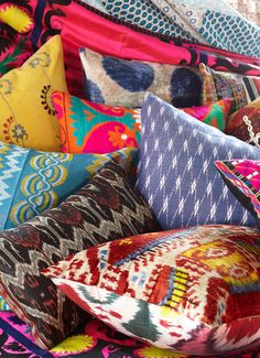 Myriad of unique hand crafted vintage pillows.