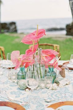 Hawaiian flowers add the perfect bit of color to a beach wedding table.
