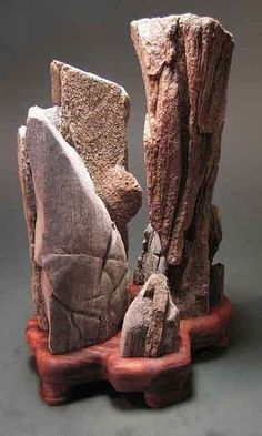 Suiseki - Japanese hobby of collecting rocks that look like landscapes and carving wooden stands to display them.