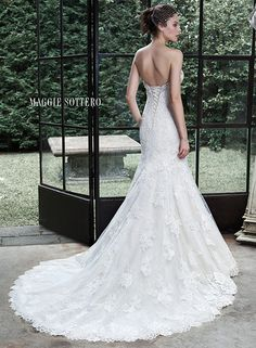 """MAGGIE SOTTERO Fall 2015 Style """"Amarosa"""" Glamorous Swarovski crystals adorn the romantic sweetheart neckline of this classic fit and flare wedding dress, comprised of tulle and hand-placed lace appliques, trailing the skirt and edging the hemline. Finished with corset closure."""