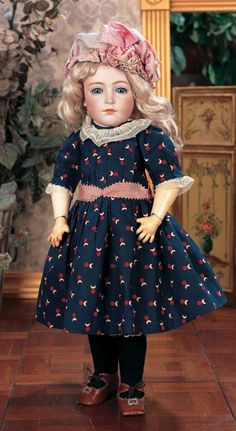 """German Bisque Character,111,by Simon and Halbig  18"""" (46 cm.) Marks: 111. Comments: Simon and Halbig,circa 1910. Value Points: very beautiful model of older child with pensive expression,enhanced by finest quality of bisque and painting,original body and body finish."""