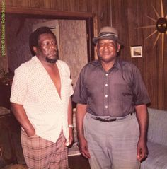 """Joe Willie Wilkins and Houston Stackhouse at Wilkins' home, 1976; photographer: Hannes Folterbauer; this photo (in black/white) has been used on the back cover of Wolf LP 120.917 (Austria 19??) """"Giants Of Country Blues Vol. 2"""""""