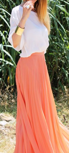 Coral pleated maxi skirt with a white shear blouse w/ gold accessories :) !!