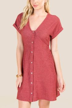 d31e38d8d31 The Serena Button Front Knit Dress features a v-neck and short sleeves.