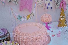 ruffle cakes homemade bunting by jjagner, via Flickr    1st birthday ruffles fabric bunting pink shabby chic vintage highchair homemade party hat