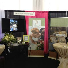 Brookhaven bridal show booth. July 2012; I like the use of small tables here.
