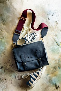 For the on-the-go guy: Gucci navy calfskin messenger bag and striped canvas sneakers— great accessories for the urban man to wear to work and casual weekend outings. Find more shoes and bags to gift this Father's Day at Neiman Marcus.