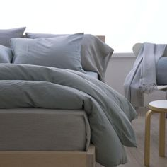 The Perla by Area Bedding is cotton sateen that is relaxed, soft and silky. Available in 5 colors: white, porcelain, celeste, slate and powder pink. Warm Grey, Brown And Grey, Flat Sheets, Bed Sheets, Shades Of Peach, Green Bedding, California King, Bedding Collections, Slate
