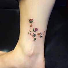 Floral aquarius constellation tattoo on the ankle.
