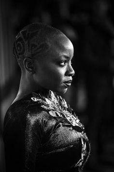 "Danai Gurira Photos - THIS IMAGE HAS BEEN CONVERTED TO BLACK AND WHITE) Danai Gurira attends the European Premiere of Marvel Studios' ""Black Panther"" at the Eventim Apollo, Hammersmith on February 8, 2018 in London, England. - European Premiere of Marvel Studios' 'Black Panther'"