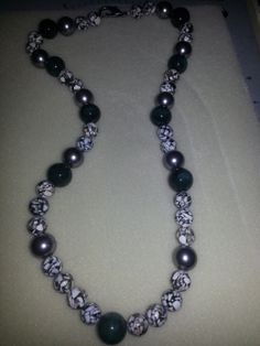 Silver green and white heavy necklace. $25