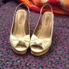 Women's size 9 Worn once for graduation. Have little saints by toes but cannot see when wearing. White with bow look. Super cute and stylish. Can wear casually or dressy. Don't have tags or box but have receipt Moda Shoes