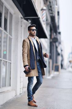 He did a great job by elevating his business casual look by layering a topcoat over his blazer