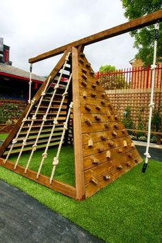 Backyard Playground use blocks of wood instead of the more expensive wall climbing holds
