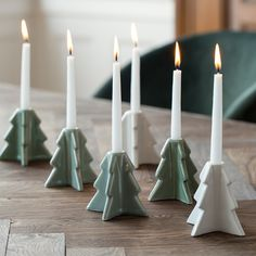 """""""You can easily display one or more trees together,"""" says Clara with a smile. Ceramic candleholder, available in three colours, price per item DKK 18,80 / EUR 2,66 / ISK 439 /JPY 298 / NOK 26,90 / GBP 2,58 / SEK 26,60"""