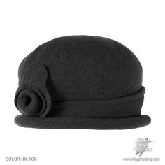 sur la tete Wool Spencer Cloche. Asymmetrical detail. $32. Reviewer says covers ears w out messing up hairstyle.