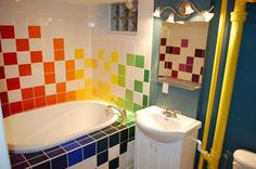 This would be an awesome kid's bathroom (I would make the coloured tiles look like tetris pieces though!)
