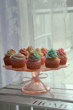 Cupcakes, pink and blue butter cream, rainbowa pattern, delicious wanilla sweets.