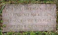 """Entrance stone to a labyrinth in the Finger Lakes, New York USA. The stone says """"Enter this labyrinth with love and reverence for all living things. May you find peace, solace and magic in its center."""""""