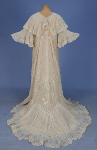 TRAINED and RUFFLED MULL PEIGNOIR with VAL LACE, 1900's. White cotton having ruffled cape collar and short bell sleeve, lavishly decorated with bands of lace, tucks, eyelet and padded embroidery over attached sleeveless silk chemise. Back
