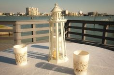 Beach Wedding Decorations - For Sale :  wedding beach boat candle diy ivory reception sea glass shells table numbers topiary white Christine  Jason Reception  0363