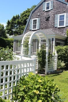 Summer view of our home. The clematis is growing and I am still in love with our blue shutters.