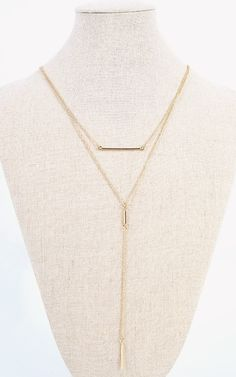 This bar necklace gives an elegant touch.   MakeMeChic.com