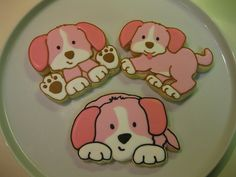 After a few weeks of baseball cookies, these pink puppy dogs for a 3-year-old's birthday were so much fun! Smiled the whole time I was decorating them!     Our photo blog: http://divinumphoto.com