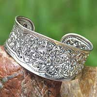 novica, wild daisies, sterling silver-artist Ploy Intha, Thailand-a silversmith, she does beautiful work..