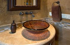 Wall mounted faucet and countertop sink. Fancy powder bath design.