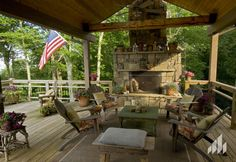 A covered backyard deck with a thinstone covered fireplace makes for cozy evening conversations. Backyard, Patio, Outdoor Living, Outdoor Decor, Fireplace Surrounds, Fireplaces, Hearth, The Great Outdoors, Photo Galleries
