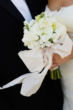 a beautiful big ivory ribbon on the bouquet