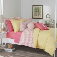 Showcasing a checked motif reversing to a solid yellow hue, this cotton comforter set brings classic style to your master suite.    Product:  Twin: 1 Comforter and 1 standard sham Full/Queen: 1 Comforter and 2 standard shams King: 1 Comforter and 2 king shamsConstruction Material: Cotton face and polyester fillColor: Moonlight yellow, pink and orangeFeatures:  Yarn-dyed Comforter reverses to pink plaid Baffled comforter for lightweight feel Hypoallergenic  Dimensions: Standard Sham: ...
