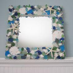 Sea Glass & Seashell Mirror Beach Decor - Shell Mirror w Sea Glass, Starfish, Pearls. $295.00, via Etsy.