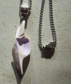 Mystical Shell Charms, Elven Ears, Mermaid Tails, Dyed Purple, Stainless Steel Chain by KreationsfromKaos on Etsy Handmade Jewelry, Unique Jewelry, Handmade Gifts, Mermaid Tails, Stainless Steel Chain, Mystic, Ears, Shells, Charmed