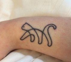 Modern cat tattoo