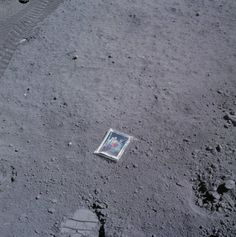"On April 23, 1972, Apollo 16 astronaut Charlie Duke placed a family photo he had brought along onto the lunar surface in an area now known as Cat Crater. The portrait shows Charlie, his wife Dorothy, and their two sons Charles and Thomas. It presumably still sits there today, just inches away from Charlie's boot print — which, presumably, is also there. Note that Cat Crater is named for ""Charles and Tom"". http://www.hq.nasa.gov/alsj/a16/AS16-117-18841.jpg"